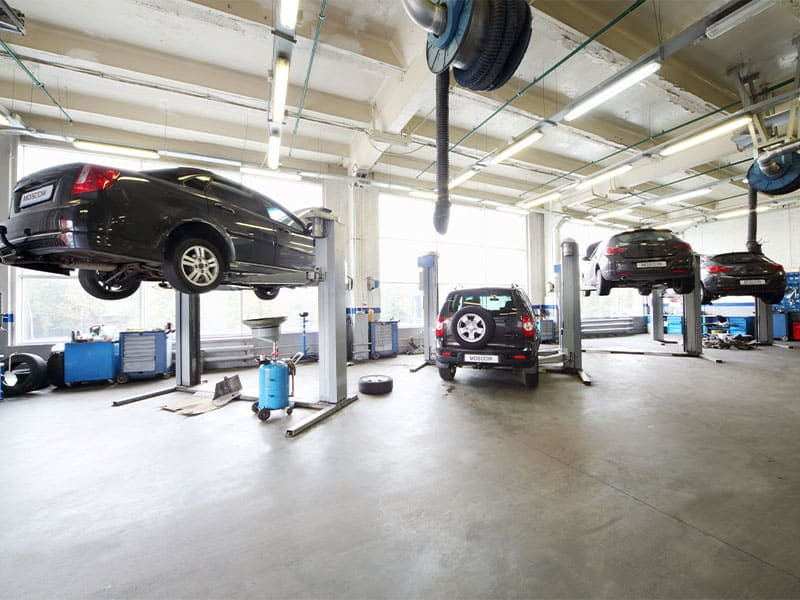 Cars on the lift in a small car service station