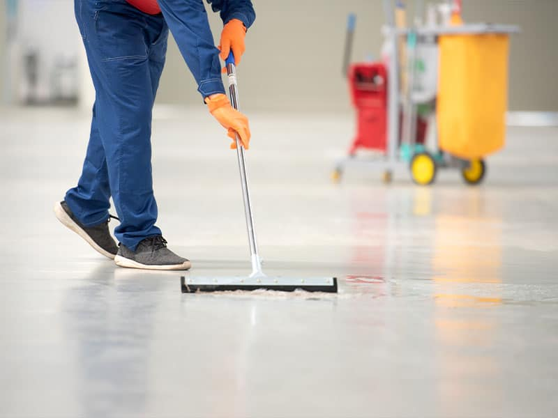 Cleaning epoxy floor in a car service center