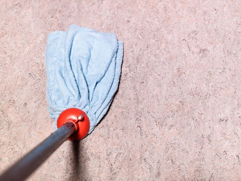Rinse the linoleum floor with a mop