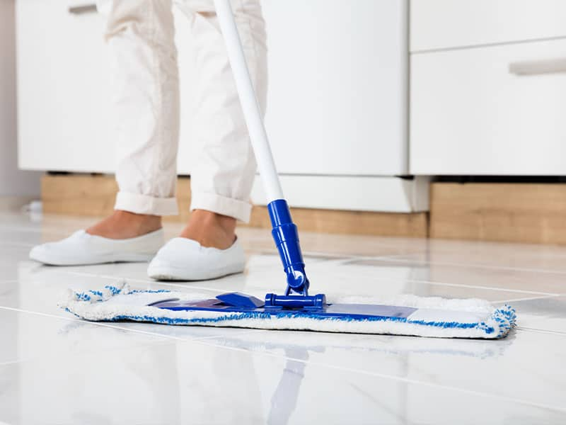 Sweep your marble floors with a dry mop