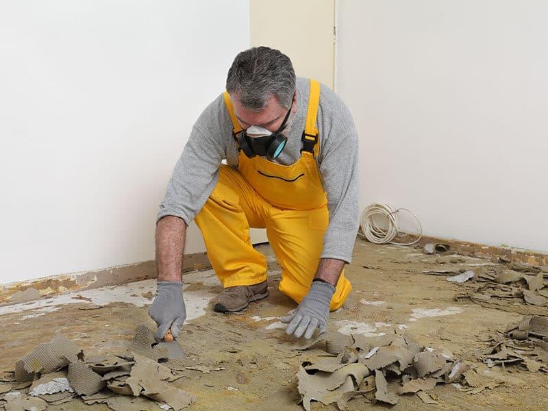 Man Removing Carpet Glue