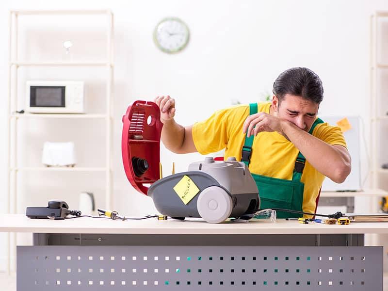 Man Repairman Repairing Vacuum Cleaner