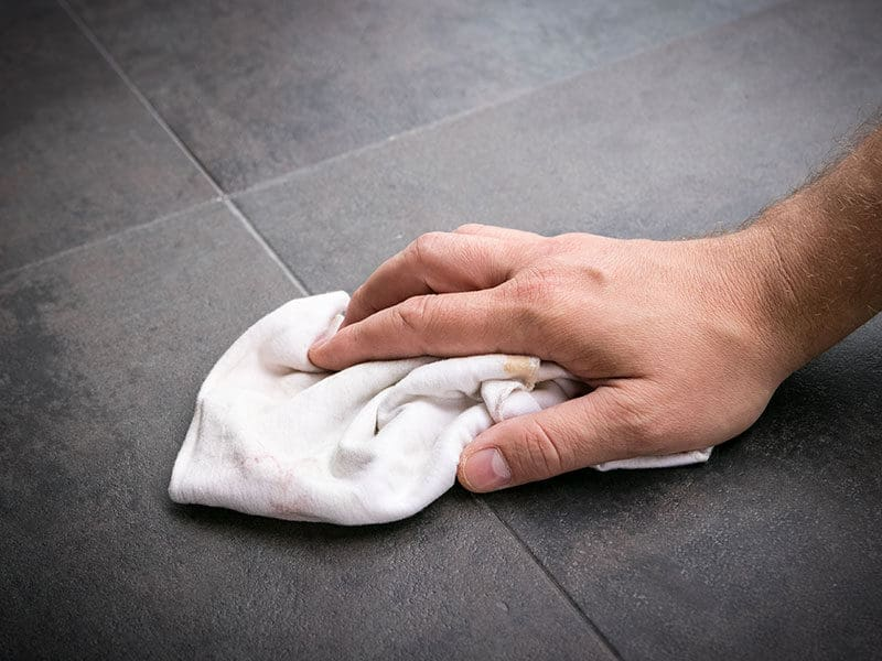 Mans Hand Wipes Clean Rag Across