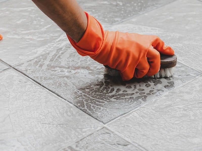 Scrub Cleaning on the Tile Floor