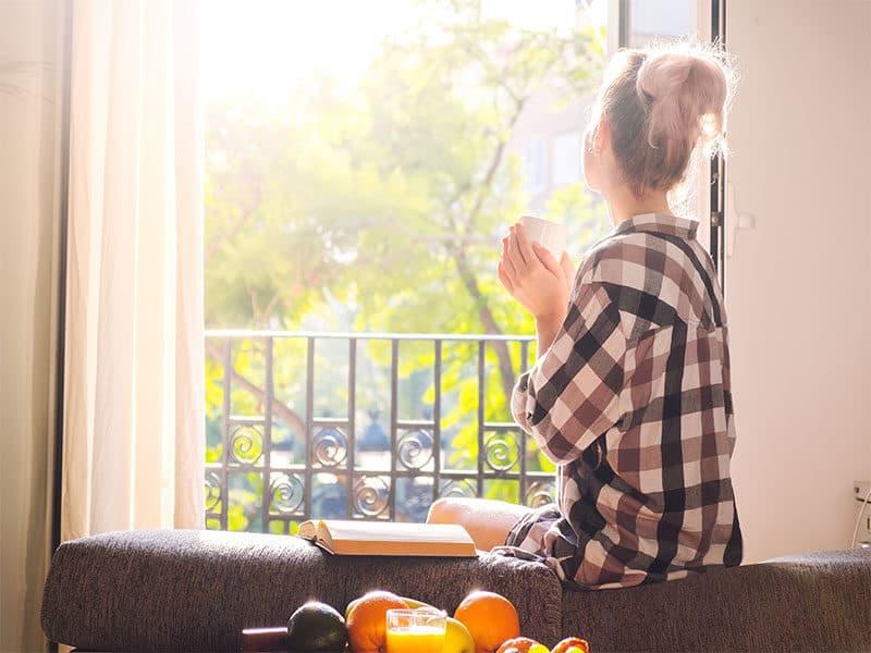 Woman Sitting Window
