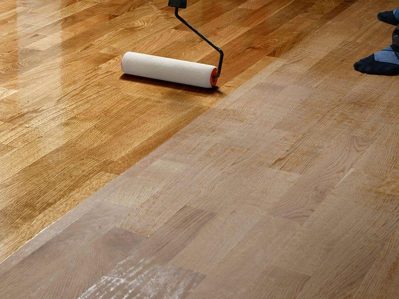Wood Floors Worker Uses Roller