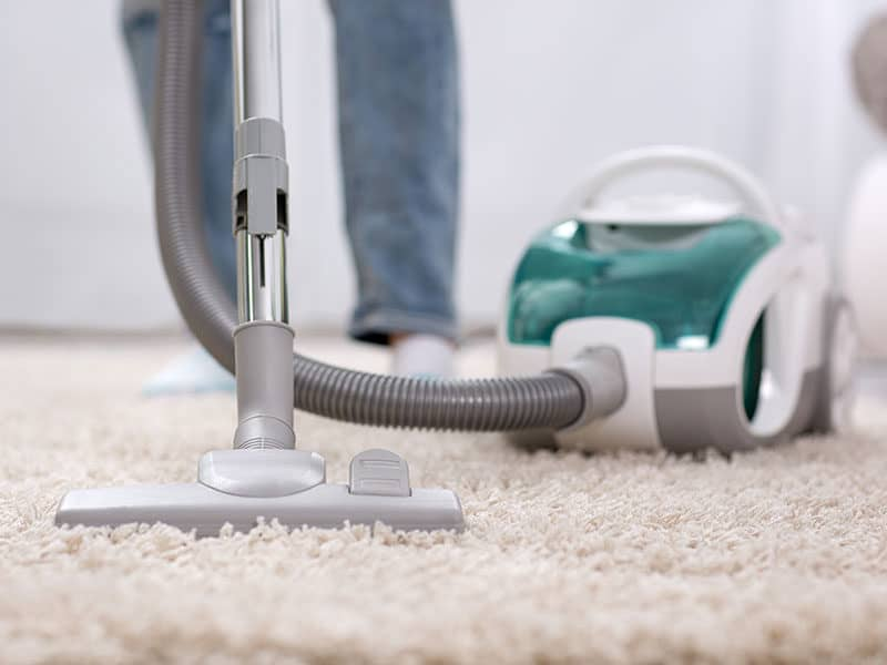 Cleaning Carpet by Vaccum