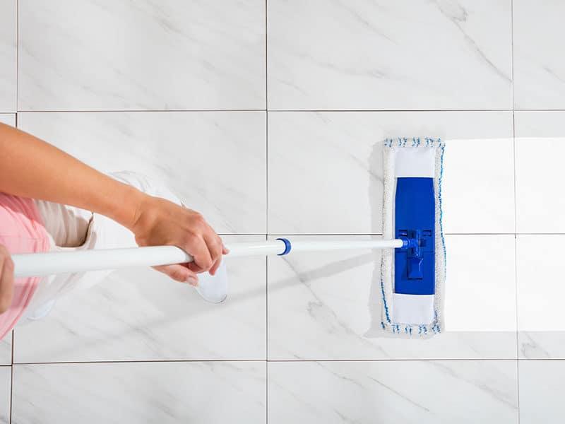 Female Cleaning White Floor