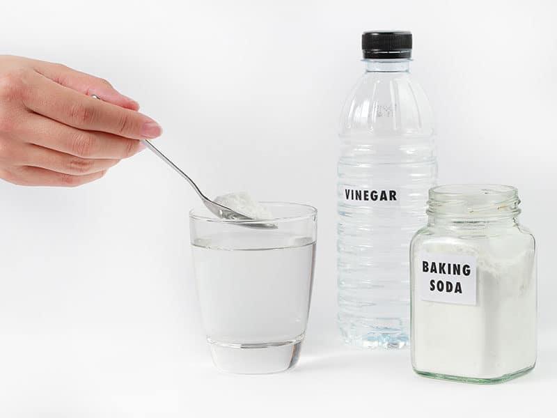 Hand Adding Baking Soda
