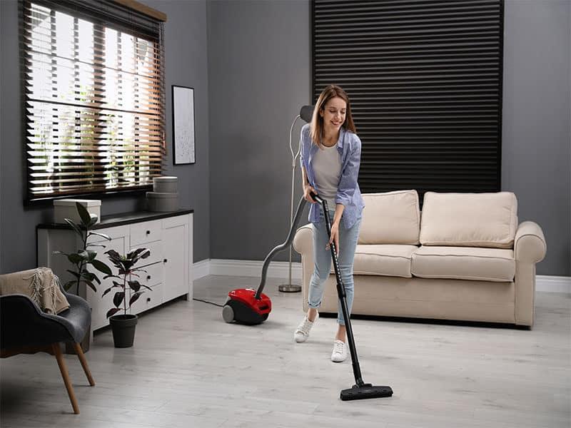 Woman Using Vacuum Cleaner