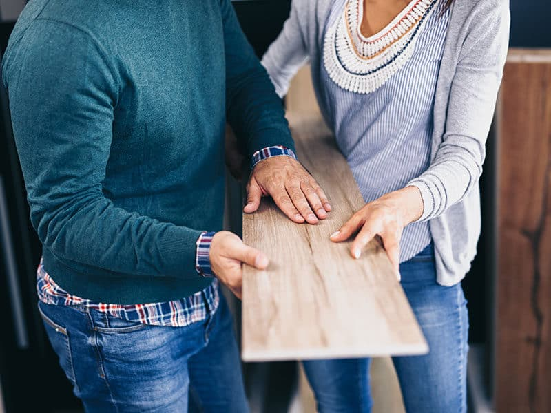 Couple Choosing Floor Laminate