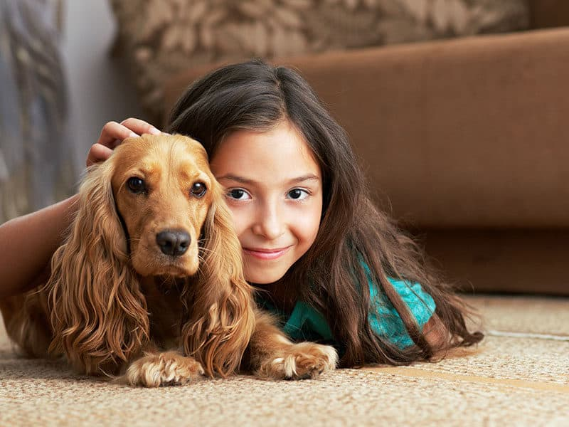 Girl Lying Floor Dog on Carpet
