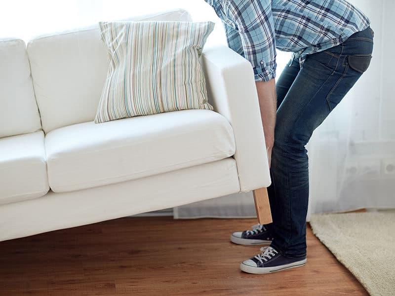 Man Moving Furniture