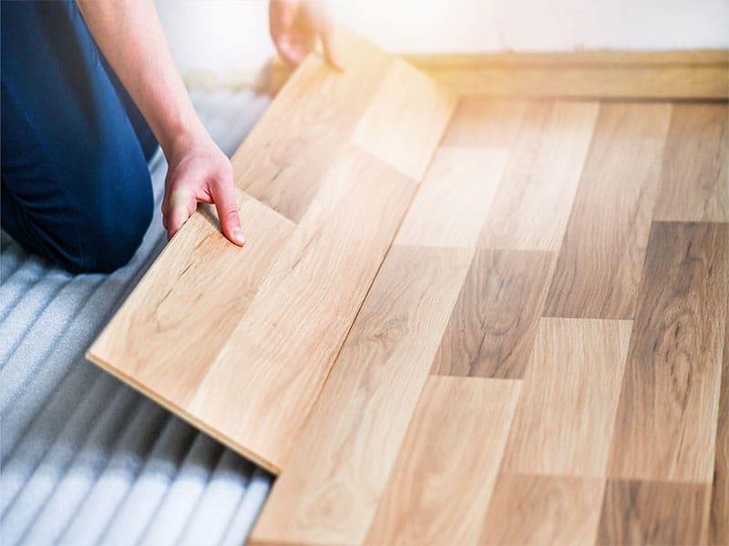 Worker Hands Installing Timber