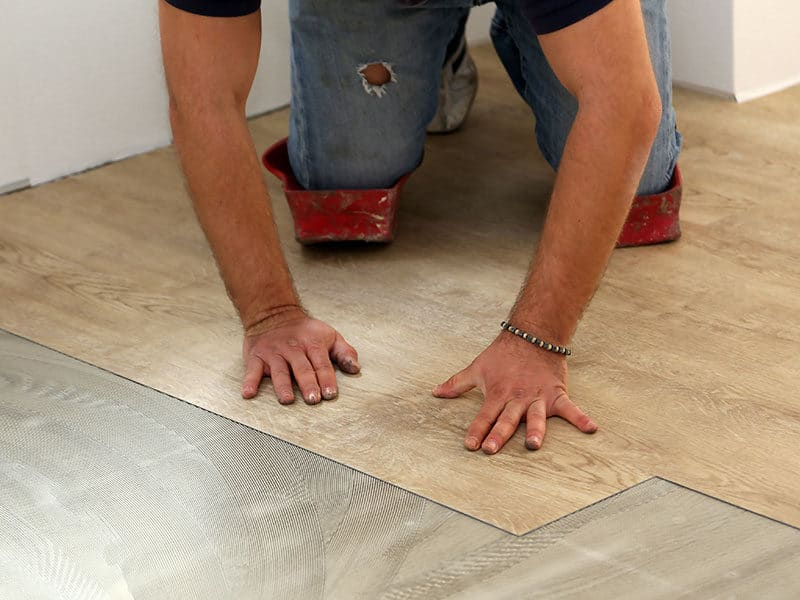 Laying Flooring Worker Install