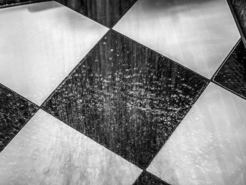 Water On Black White Tiled